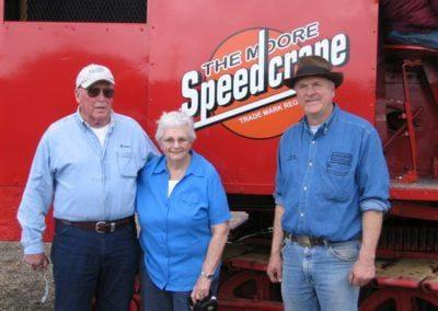 Pictured from left to right: Lou and Erma McMaster the previous owners of the Moore Speedcrane and Larry Kotkowski of Lakeside Sand & Gravel